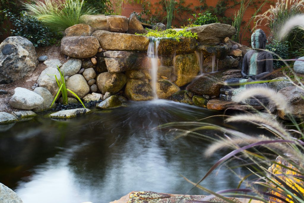 Koi pond and custom hardscape built by Stonewall Creek.