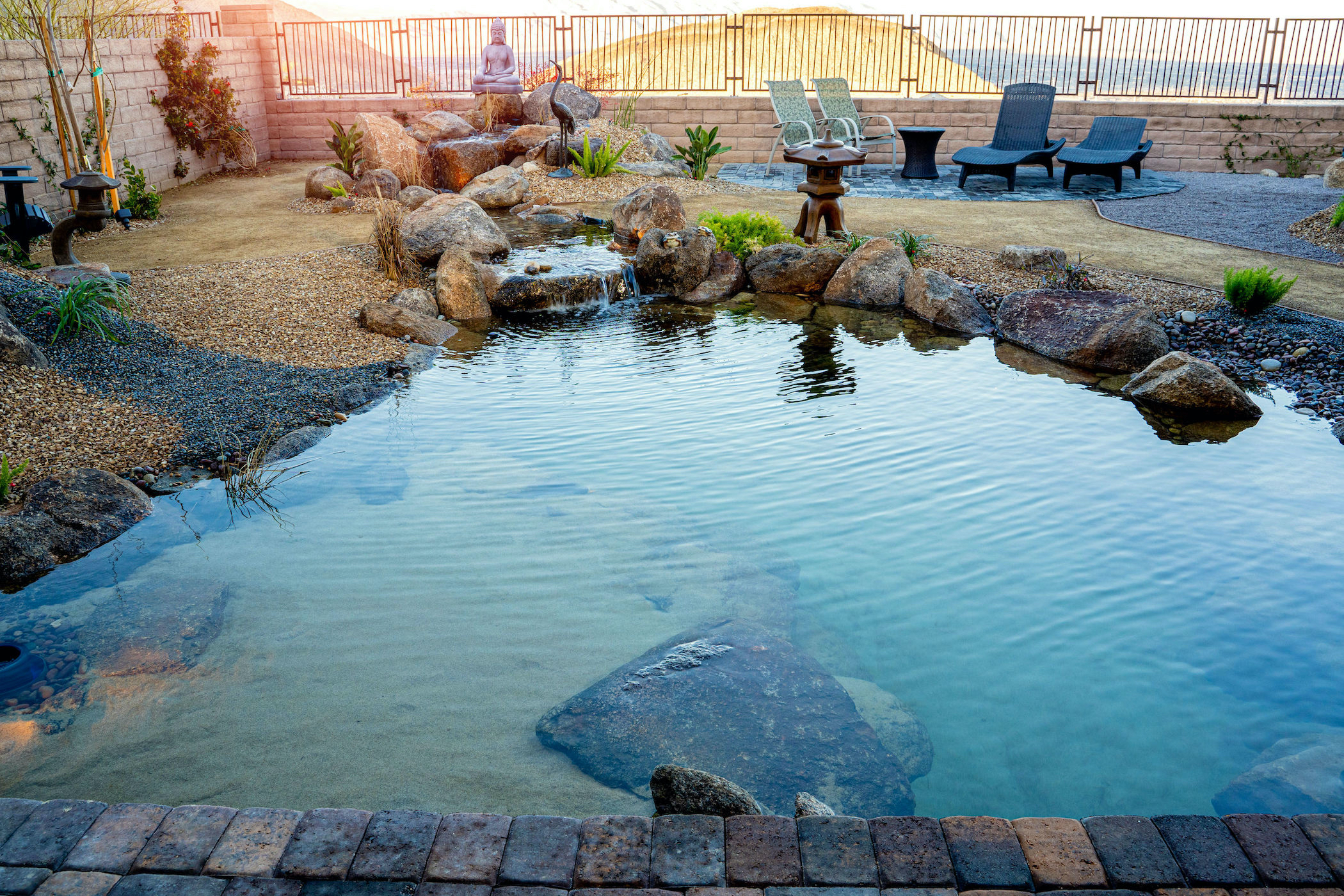 Koi pond maintained by Stonewall Creek's pond maintenance service.